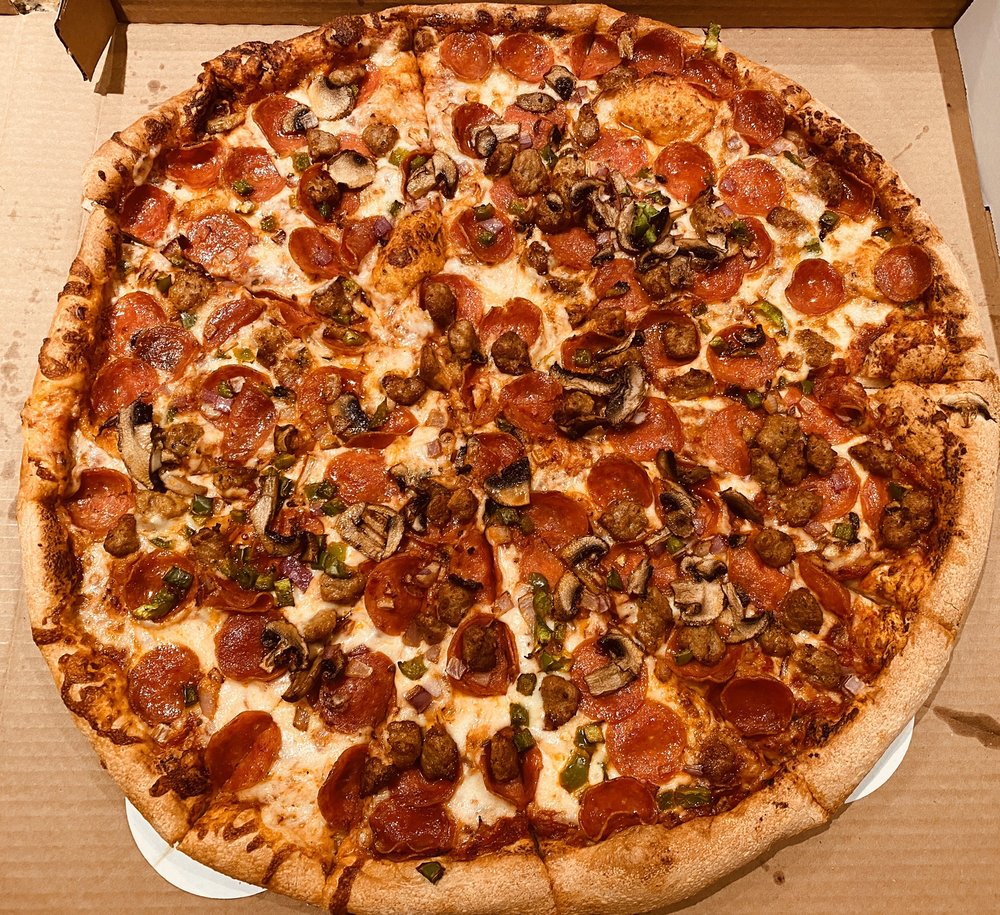 Zesty Zzeeks Pizza & Wings 4050 S Arizona Ave suite 4, Chandler